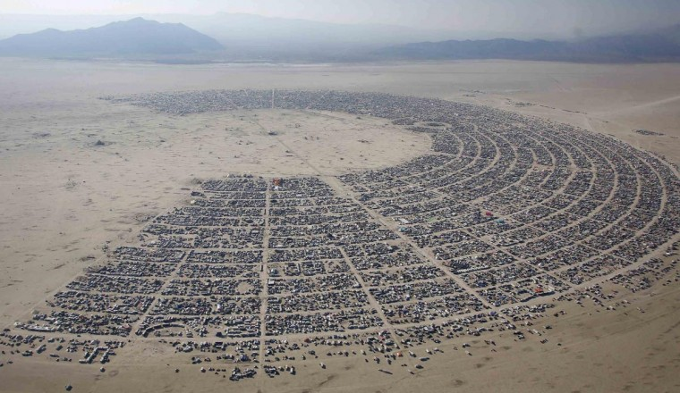 An aerial view of the Burning Man 2013 arts and music festival is seen in the Black Rock Desert of Nevada, August 29, 2013. The federal government issued a permit for 68,000 people from all over the world to gather at the sold out festival, which is celebrating its 27th year, to spend a week in the remote desert cut off from much of the outside world to experience art, music and the unique community that develops. (Jim Urquhart/Reuters)