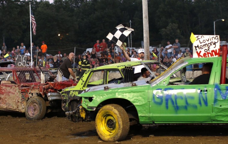 Drivers compete in the Nation-Wide Demolition Derby at the New Jersey State Fair Sussex County Farm and Horse Show in Augusta, New Jersey, August 4, 2013. Originally begun in the 1950's in the United States, Demolition Derbies have been popular at state and county fairs throughout the U.S. and have spread to western Europe and Asia. (Mike Segar/Reuters)