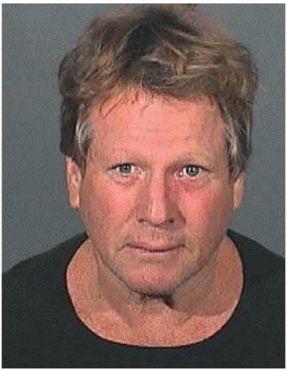 Actor Ryan O'Neal is shown in a booking mug shot released by the Los Angeles County Sheriff Department to Reuters September 17, 2008, following his arrest along with his son Redmond O'Neal Wednesday for possession of a controlled substance. O'Neal and his son were each being held in jail in lieu of $10,000 bail, a sheriff's spokesperson said. REUTERS/Los Angeles County Sheriffs Department/Handout