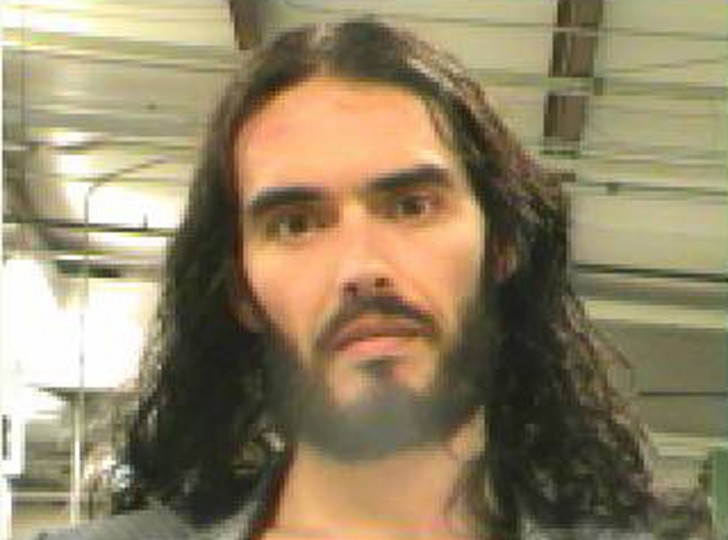 British actor Russell Brand is pictured in this booking photograph handout released by the Orleans Parish Sheriff's Office March 15, 2012. An arrest warrant for Brand has been issued in New Orleans, after a photographer accused the British comedian and actor of grabbing his iPhone and tossing it through a window on Monday, police said on Thursday. REUTERS/Orleans Parish Sheriff's Office/Handout