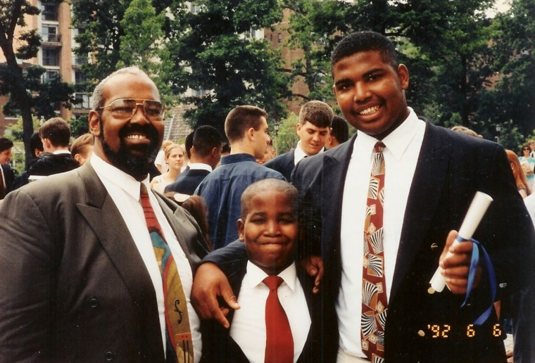 Jonathan Ogden, right, holds his diploma at his graduation from St. Albans School in 1992. With him are his father Shirrel Ogden, left, and brother Marques. (Handout photo)