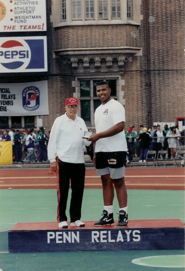 Jonathan Ogden, right, receives an award at the Penn Relays in Philadelphia. (Handout photo)