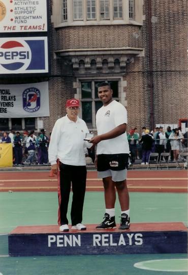 Jonathan Ogden, right, receives an award at the Penn Relays in Philadelphia. (Handout photo)