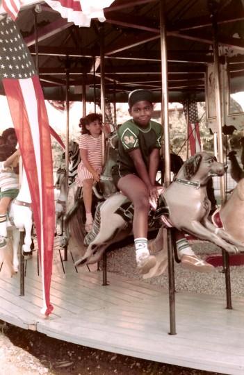Jonathan Ogden, 7, rides a merry-go-round in Wildwood, N.J. (Handout photo)