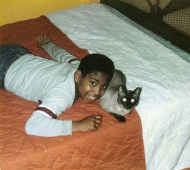 A young Jonathan Ogden with a family cat. (Handout photo)