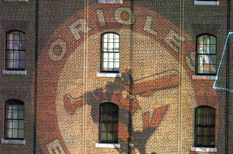 From the warehouse: The Orioles logo is projected on the warehouse wall at Oriole Park at Camden Yards on Opening Day, April 4, 2004. (Lloyd Fox/Baltimore Sun Photo)