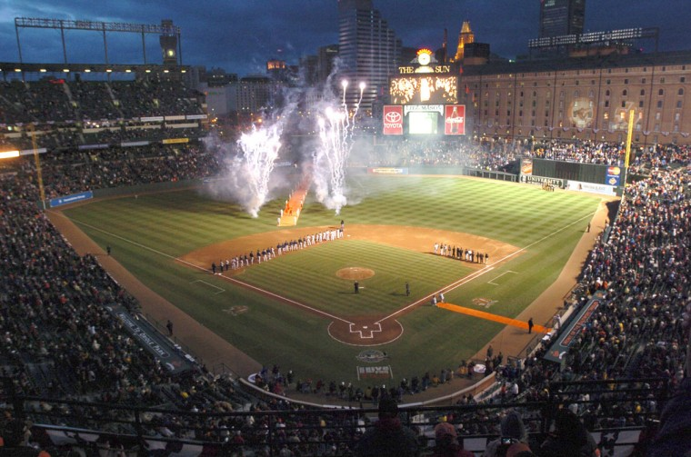 Illuminated: Fans watch fireworks light up Oriole Park at Camden Yards during Opening Day ceremonies on April 4, 2004. (Lloyd Fox/Baltimore Sun Photo)