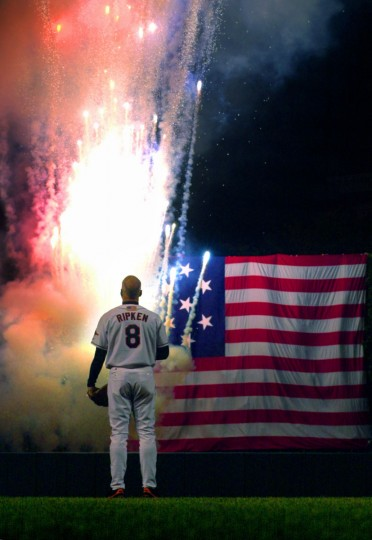As the guest of honor: Orioles third baseman Cal Ripken watches fireworks erupt in colors beside the U.S. flag from Fort McHenry as the Star Spangled Banner plays at Oriole Park at Camden Yards to honor him on his final game before his retirement Sat., Oct. 6, 2001. Ripken played in 3,001 games throughout his career, with a lifetime .276 batting average. (Baltimore Sun/Karl Merton Ferron)