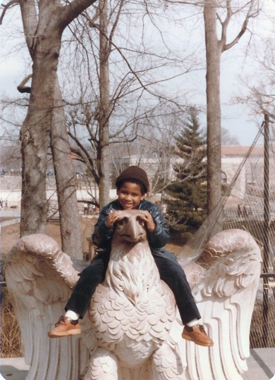 Jonathan Ogden climbs aboard an eagle statue on family trip to Canada. (Handout photo)