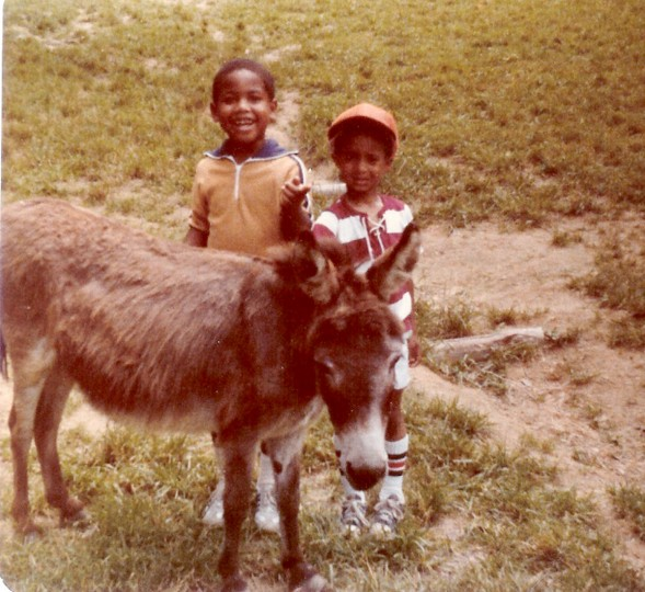 Jonathan Ogden, left, and friend Lee Hall on a visit to a petting zoo. (Handout photo)