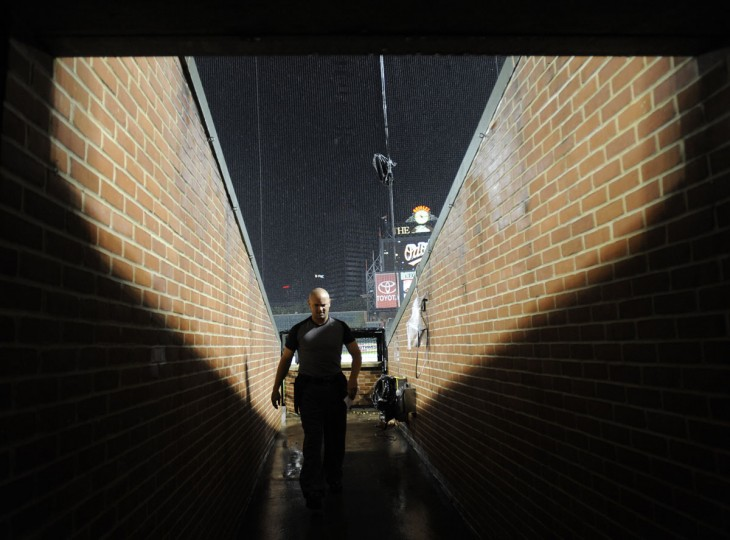 From a tunnel: Home plate umpire Scott Barry walking back to the umpires room after looking out at the field during a rain delay at Oriole Park at Camden Yards on July 23, 2008. The game would be suspended and played the next day. (Lloyd Fox/Baltimore Sun Photo)