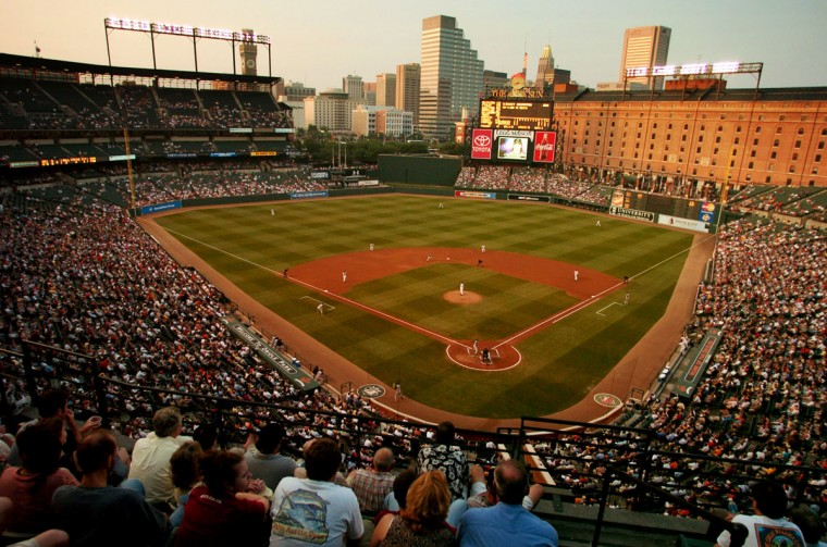 During sunset: Orioles fans watch a game in June 2004 as day turns into night. Not pictured: Behind-the-scenes discussions about moving a baseball team to Washington. (Gene Sweeney Jr./Baltimore Sun Photo)