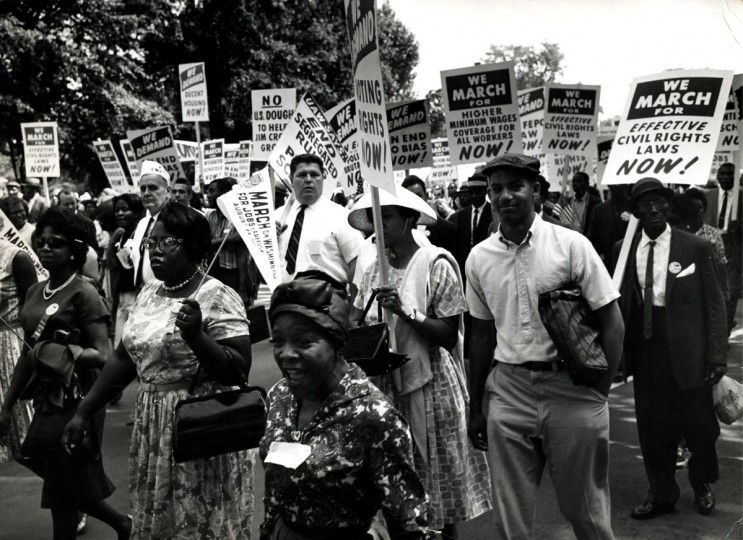 View of marchers as they walk along the National Mall during the March on Washington for Jobs and Freedom, Washington DC, August 28, 1963. The march and rally provided the setting for the Reverend Martin Luther King Jr's iconic 'I Have a Dream' speech. (PhotoQuest/Getty Images)