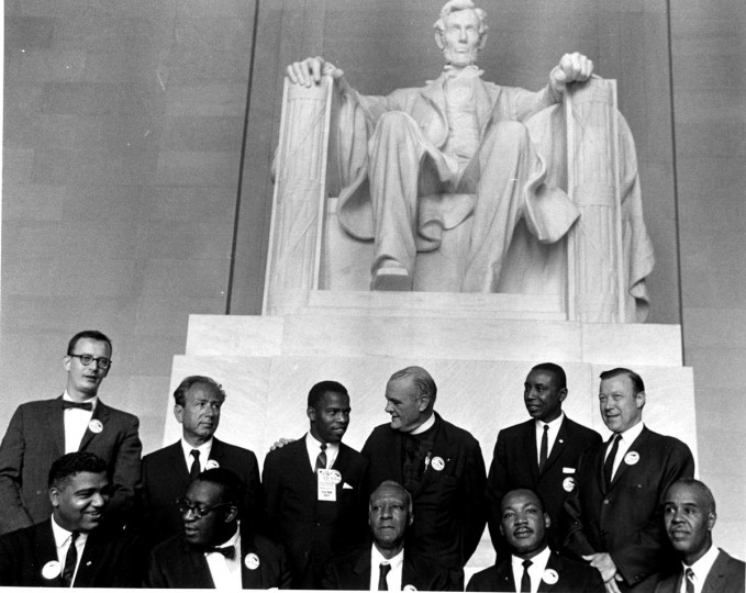 Civil Rights leaders pose in the Lincoln Memorial during the March on Washington for Jobs and Freedom, Washington DC, August 28, 1963. Pictured are, standing from left, director of the National Catholic Conference for Interracial Justice Matthew Ahmann, Rabbi Joachim Prinz (1902 - 1988), Student Nonviolent Coordinating Committee (SNCC) leader John Lewis, Protestant minister Eugene Carson Blake (1906 - 1985), Congress of Racial Equality (CORE) leader Floyd McKissick (1922 - 1991), and labor union leader Walter Reuther (1907 - 1970); sitting from left, National Urban League executive director Whitney Young (1921 - 1971), unidentified, labor union leader A Philip Randolph (1889 - 1979), Dr. Reverend Martin Luther King Jr. (1929 - 1968), and National Association for the Advancement of Colored People (NAACP) leader Roy Wilkins (1901 - 1981). The march and rally provided the setting for the Dr. King iconic 'I Have a Dream' speech. (Photo by PhotoQuest/Getty Images)
