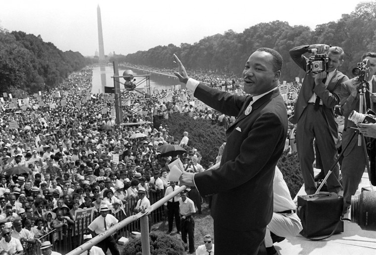 "U.S. civil rights leader Martin Luther King, Jr. (C) waves to supporters from the steps of the Lincoln Memorial on August 28, 1963 on the Mall in Washington D.C. during the March on Washington. August 28 marks the 50th anniversary of the famous ""I Have a Dream"" speech, which is credited with mobilizing supporters of desegregation and prompted the 1964 Civil Rights Act. (AFP/Getty Images)"