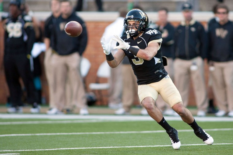"Name: Michael Campanaro College: Wake Forest Position: Wide receiver Year: Senior High school: River Hill Hometown: Clarksville 2012 stats: 79 catches for 763 yards and six touchdowns, 16 carries for 82 yards and one touchdown. Second-team All-ACC selection. A broken hand sidelined Campanaro for two games in 2012, but the former Baltimore Sun first-team All-Metro selection had already done plenty of damage for the Demon Deacons. In his redshirt junior season, Campanaro developed into one of the most dangerous offensive players in the ACC. He enters this year as a preseason All-ACC selection at wide receiver. ""It's definitely great to see,"" Campanaro told The Sun. ""It's just very honoring being listed ahead of a lot of big-time names and next to a guy like [Clemson's] Sammy Watkins. It's awesome to be recognized that way, and recognition for Wake Forest in anything is positive. Anything that directly shines some light on Wake Forest, that's always good. Preseason awards don't mean anything unless you go out there and earn them. I'm just looking for us to go out there and earn recognition."" Wake Forest hasn't had a winning season since Campanaro has been in Winston-Salem, but he's hoping that changes this fall. Campanaro says he's 100 percent healthy and prepared for his final year of college. ""Coming to a school like Wake Forest, the first two years I was here and didn't play too much. I was redshirted and dealt with a few injuries but continued to work hard,"" Campanaro said. ""I believed in my abilities for playing in the field and always had confidence with Coach [Jim] Grobe and this coaching staff. I've always been in great hands with those guys. Just kept working hard and now I'm looking forward to my senior season."" Photo credit: USA Today Sports"