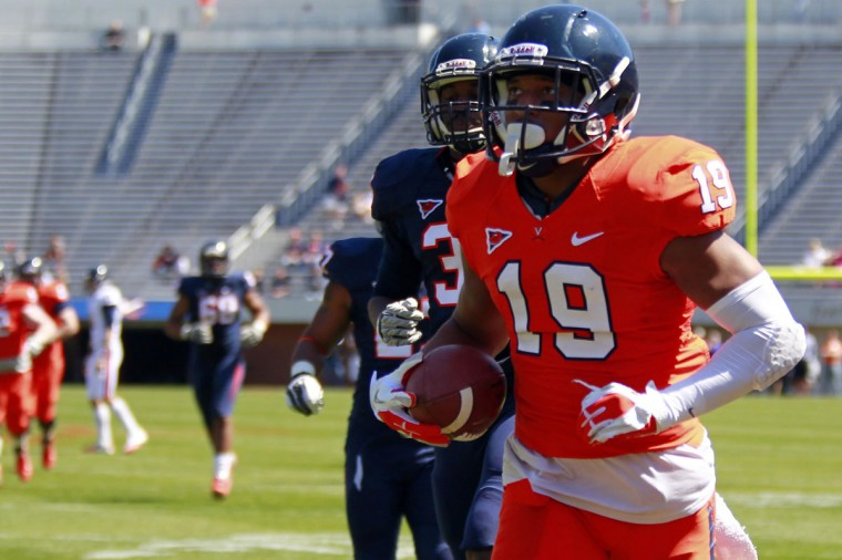 "Name: E.J. Scott College: Virginia Position: Wide receiver Year: Junior High school: Good Counsel Hometown: Ellicott City 2012 stats: 29 catches for 390 yards and three touchdowns D.C. high school football fans will be more familiar with Scott, a former Good Counsel star. But the Ellicott City native and Virginia wide receiver has always considered himself to be a ""Baltimore-area guy."" ""I say I'm family with a lot of guys in the Baltimore area. We still keep in touch,"" said Scott, one of five former Falcons stars on the Cavaliers' roster. ""All my family is from the Baltimore area. Growing up with guys from even like little league, it was all Howard County and the Baltimore area."" Fellow Cavaliers receiver – and 7-on-7 selection – Darius Jennings was one of those Baltimore guys Scott grew up playing against, including when Scott's Falcons met Jennings' Gilman Greyhounds in the fall of 2009. Both players this season should play integral roles for the Cavaliers. ""I'm playing inside at the X position right now,"" Scott said. ""It's a good fit. Usually the smaller guys play on the inside. Quick guys as well. Outside is usually big guys to stretch the field. We have a lot of different guys in our group. Inside is a good fit. ""As a team, we're just trying to build from last year. We've got a lot of great guys returning. We've got depth at a lot of positions. We're excited to make a statement this year."" Photo credit: USA Today Sports"