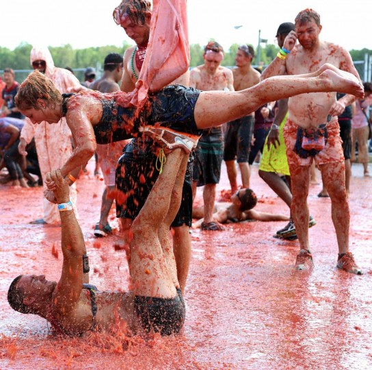 Participants take part in the Tomato Royale, a tomato food fight at the Great Bull Run on August 24, 2013. (Credit: Kaitlin Newman)