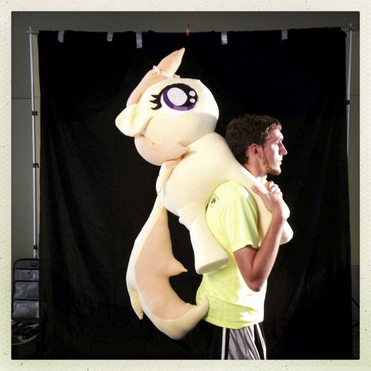 "Derek Robbin, of High Point, N.C., walked around BronyCon carrying Noi, one of the background fillies. ""She stood out to me because I really like warm colors, and she's pretty much all warm colors,"" he said. As far as why he likes 'My Little Pony: Friendship is Magic,' he said ""a couple of friends watched it, I liked it and liked the community, so I figured why not come down and meet up with some people."" (Christopher T. Assaf/Baltimore Sun Photo)"