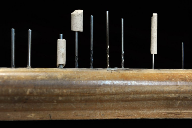 Drill bits are used to measure the gauge of the interior hole of pieces of colonial clay pipes to help with dating. (Kenneth K. Lam/Baltimore Sun)