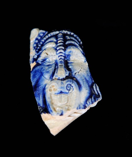 The decorative maskette from the neck of a Rhenish stoneware jug (c. 1650-1700) from the collection at the Historical St. Mary's City's museum. (Kenneth K. Lam/Baltimore Sun)