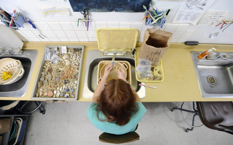 Erin Crawford, a Junior anthropology student at Towson University, cleans historical artifacts unearthed from archaeological dig sites in Historical St. Mary's City. (Kenneth K. Lam/Baltimore Sun)