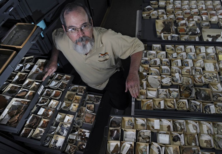 Silas D. Hurry, Curator of Collections and Archaeological Laboratory Director at the Historical St. Mary's City's museum is surrounded by colonial artifacts unearthed in St. Mary's City. (Kenneth K. Lam/Baltimore Sun)