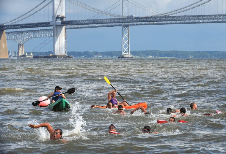 The rescue race takes place with the Bay Bridge in the background. (Algerina Perna/Baltimore Sun)
