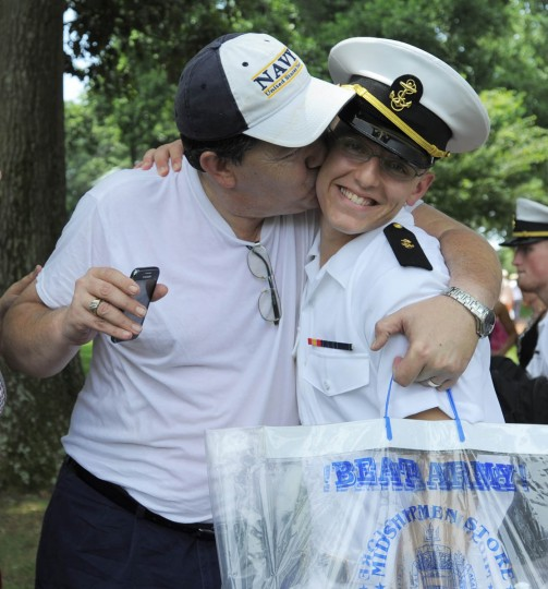 Carl Mckay Sr. of Alabama kisses son Midshipman Carl McKay Jr. ( Erin Kirkland/Baltimore Sun)