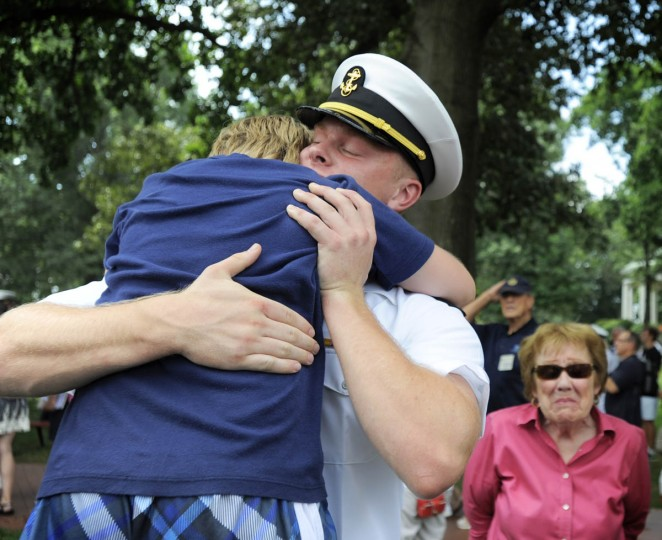 A midshipman is reunited with family and friends since beginning Plebe Summer six weeks ago. (Erin Kirkland/Baltimore Sun)