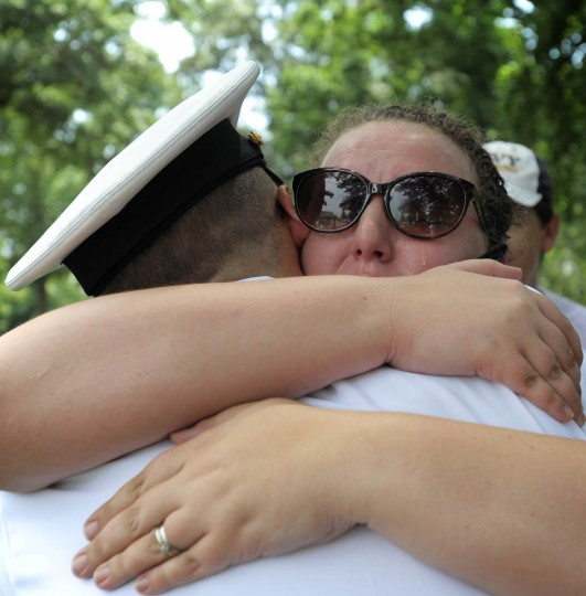 Midshipman Carl McKay of Alabama hugs his sister Kayla Chambers while she cries and tells him how proud she if of him. (Erin Kirkland/Baltimore Sun)