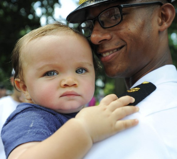 Midshipman Isaac Taylor holds onto younger brother Zachary. (Erin Kirkland/Baltimore Sun)