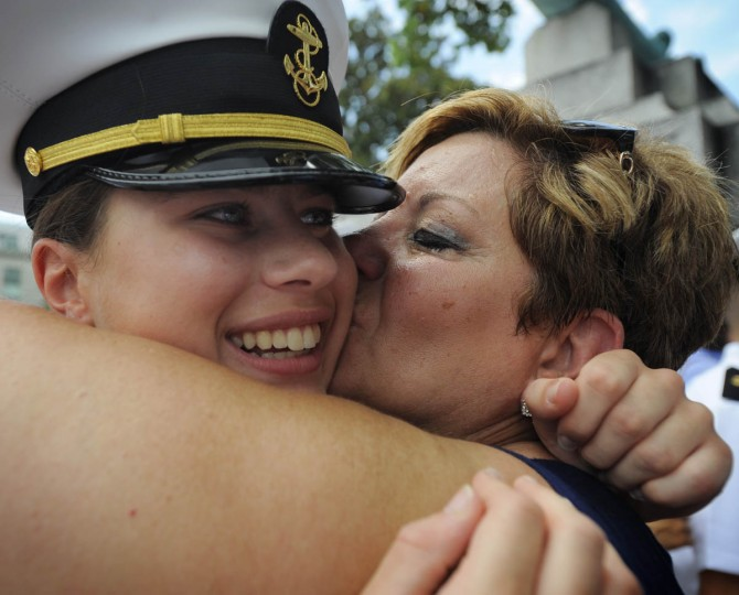 Midshipman Mikaela Sakach of Boston embraces her mother, Linda McNally. Friday was the first opportunity that members of the Naval Academy's Class of 2017 could reunite with friends and family since beginning Plebe Summer six weeks ago. (Erin Kirkland/Baltimore Sun)