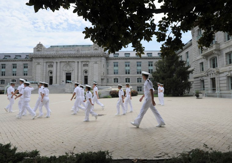 Plebes walk to noon formation before being released for the summer. Friday was the first opportunity that members of the Naval Academy's Class of 2017 could reunite with friends and family since beginning Plebe Summer six weeks ago. (Erin Kirkland/Baltimore Sun)