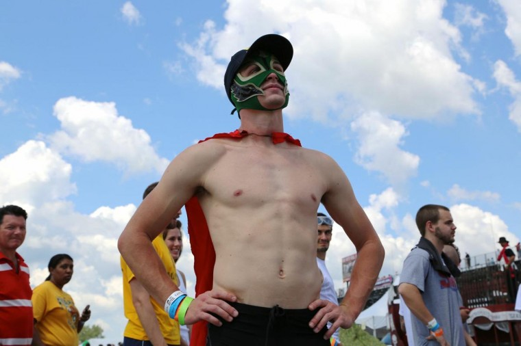 Zach Willis, 24, of South Carolina wears a mask and cape at the Great Bull Run. (Credit: Kaitlin Newman)