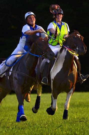 Becher Cole, riding Dan, gallops in to stick-check Sabrina Dobbins (riding Oliver) and knock the ball from her possession during the Bay Area Polocrosse team's practice in southern Maryland. (Karl Merton Ferron/Baltimore Sun)