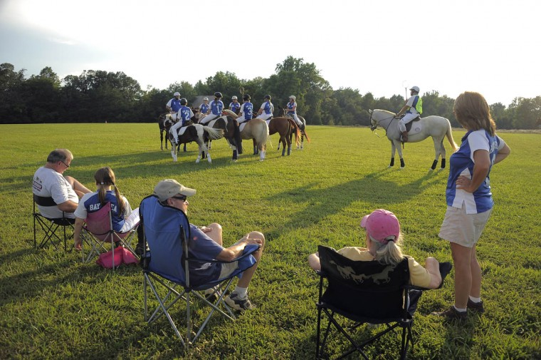 People sit in lawn chairs as the Bay Area Polocrosse team gathers for practice. (Karl Merton Ferron/Baltimore Sun)
