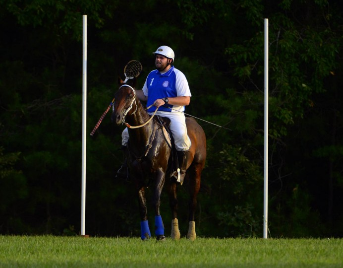Ryan Trueblood, riding Bear, is between goal posts as he gives instruction during Bay Area Polocrosse's practice in southern Maryland. (Karl Merton Ferron/Baltimore Sun)
