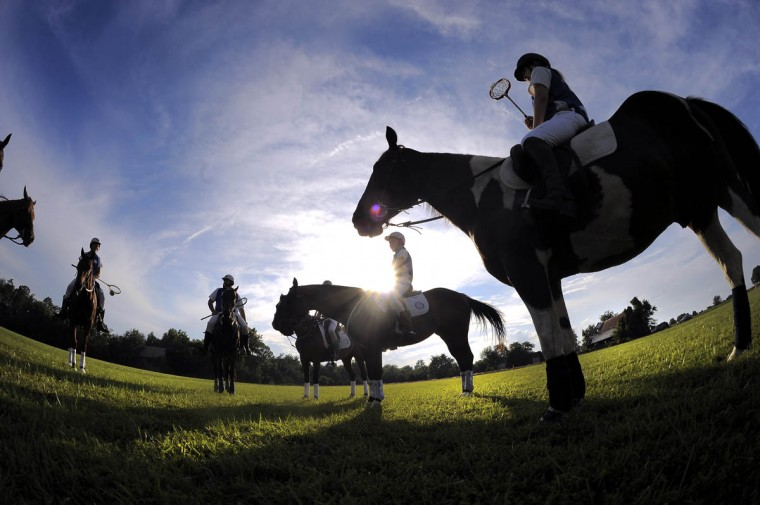 Members of the Bay Area Polocrosse team gather to begin practice at an open field in southern Maryland. (Karl Merton Ferron/Baltimore Sun)