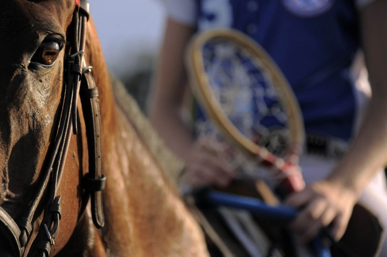 The setting sun illuminates Posh, as Haley Blend, 15, sits atop the horse during the Bay Area Polocrosse team's practice in southern Maryland. (Karl Merton Ferron/Baltimore Sun)