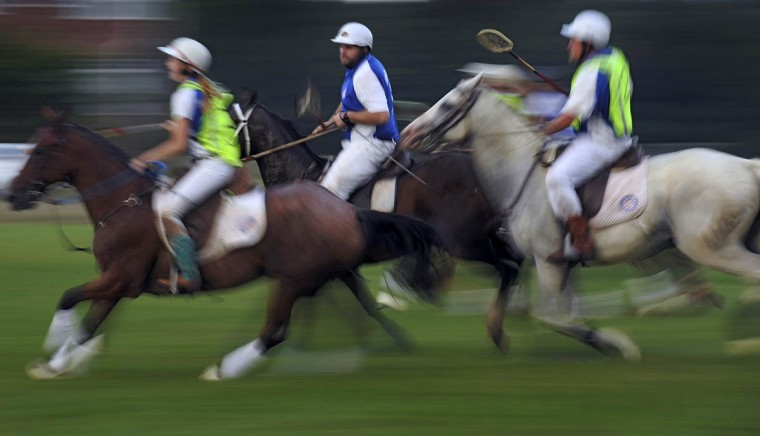 A slow shutter speed creates pastels in motion as the Bay Area Polocrosse team practices at an open field in southern Maryland. (Karl Merton Ferron/Baltimore Sun)