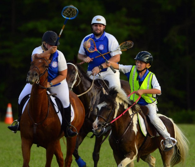 Ryan Trueblood, riding Bear (background center), watches as Tristan Cole, riding Cherokee, avoids the stick check of Christy Dean, riding Lena, as Cole brings the ball upfield during practice. (Karl Merton Ferron/Baltimore Sun)