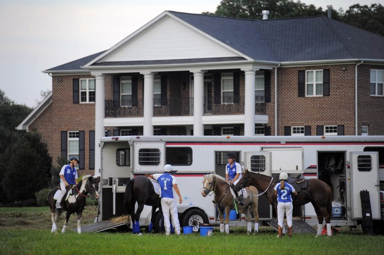 Participants with the Bay Area Polocrosse team break in front of a mansion during team practice. (Karl Merton Ferron/Baltimore Sun)