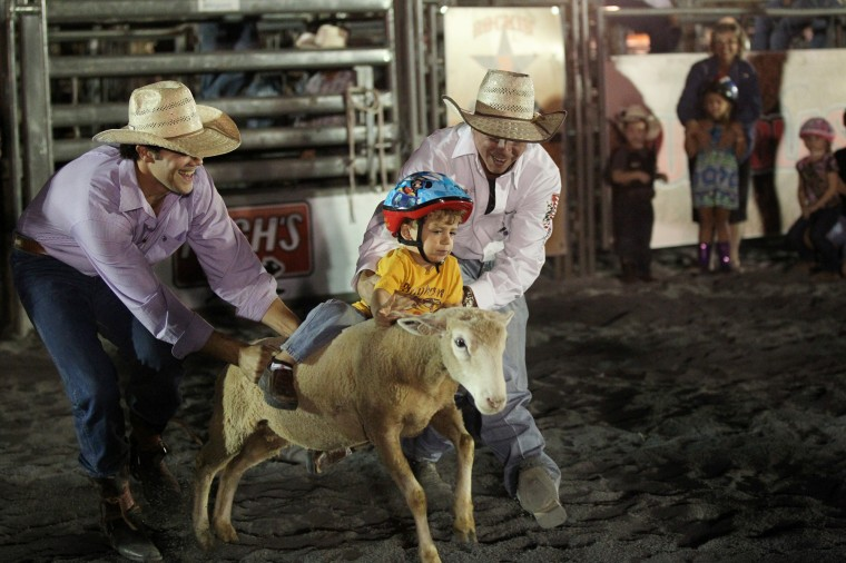 Bodie Winfield, 2, of Middletown rides a sheep during the Bull Blast. (Jen Rynda/BSMG)