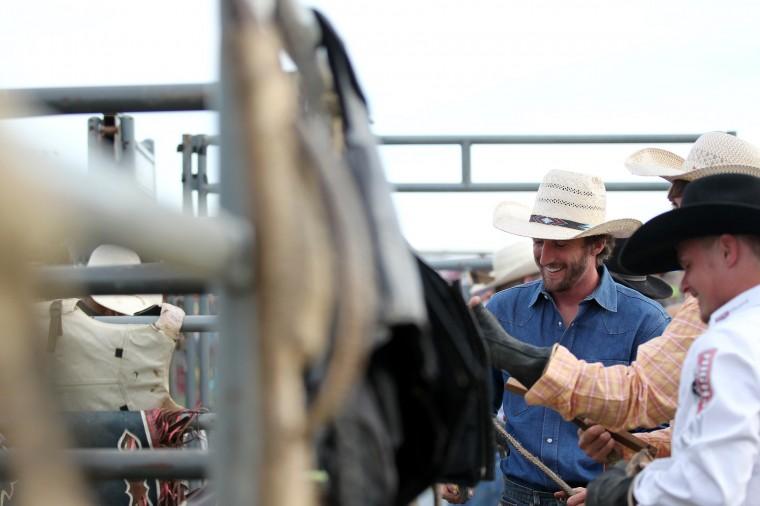Bull rider Kyle Andrews, center, of Valley, Ala. gets ready for the Bull Blast. (Jen Rynda/BSMG)