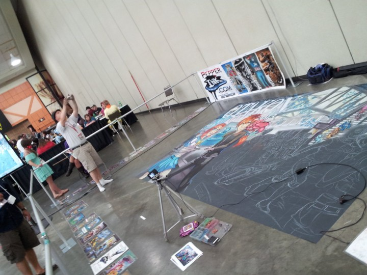 Eric Michael Maruscsk surveys his chalk replica of this year's Otakon promotional art. He began coloring the piece on Friday morning. (Carrie Wood/For the Darkroom)