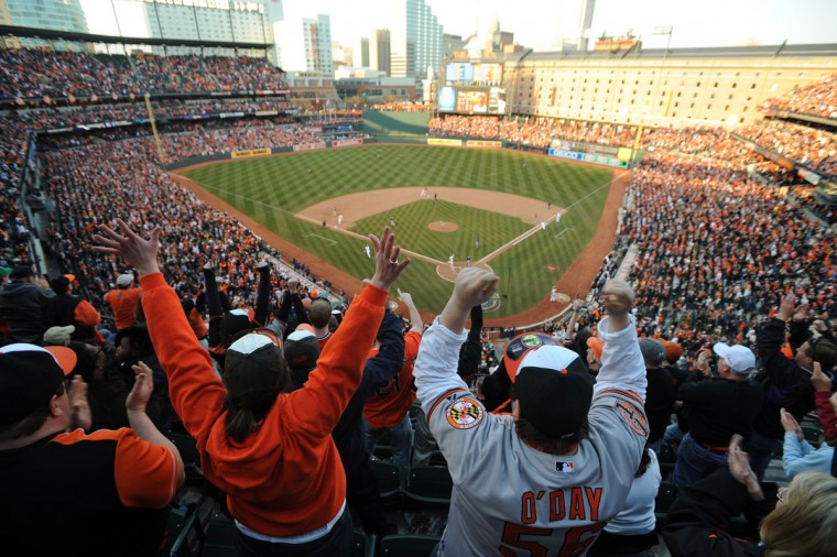 While you're cheering: Fans react to a game-tying Adam Jones single in the eighth inning of the Orioles' home opener on April 5, 2013 at Oriole Park at Camden Yards. (Jerry Jackson/Baltimore Sun Photo)
