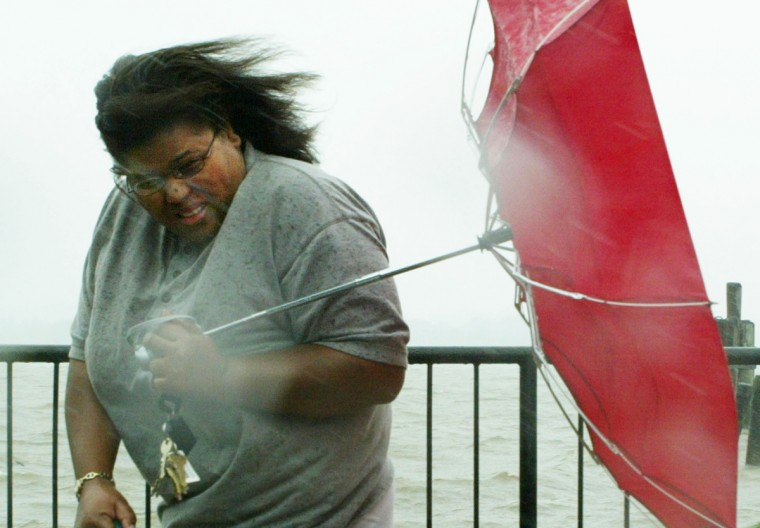 Tiffaney Battle tries to hold her umbrella as Hurricane Isabel approaches the region September 18, 2003 in Old Town Alexandria, Virginia. Hurricane Isabel made landfall September 18 on the Outer Banks, a thin band of islands off the North Carolina coast. (Alex Wong/Getty Images)