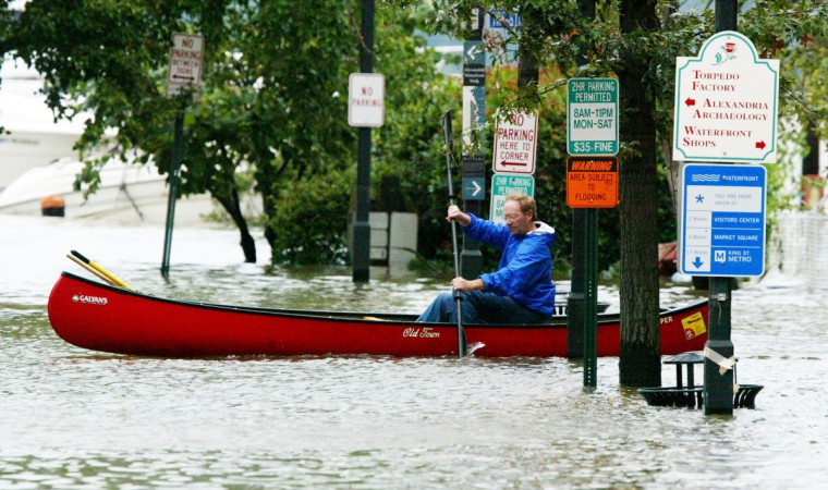 Old Dominion Boat Club Manager John Sterling rows a canoe on flooded King Street September 19, 2003 in Old Town Alexandria, Virginia. Significant flooding was caused by Hurricane Isabel, now a tropical storm, at the water front areas of Old Town Alexandria with water as deep as six feet in some places. (Alex Wong/Getty Images)