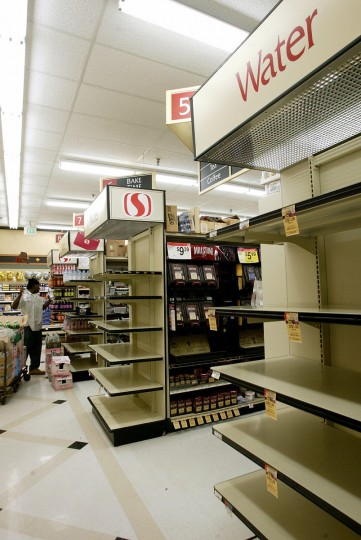 A grocery store in Old Towne Alexandria that had a run on water is being replenished by a distributor 19 September 2003, in Virginia. Hurricane Isabel knocked out power to over one million Virginia residents and left the water supply contaminated, residents of certain counties have been urged to boil their water or use bottled water.(Stephen Jaffe/Getty Images)